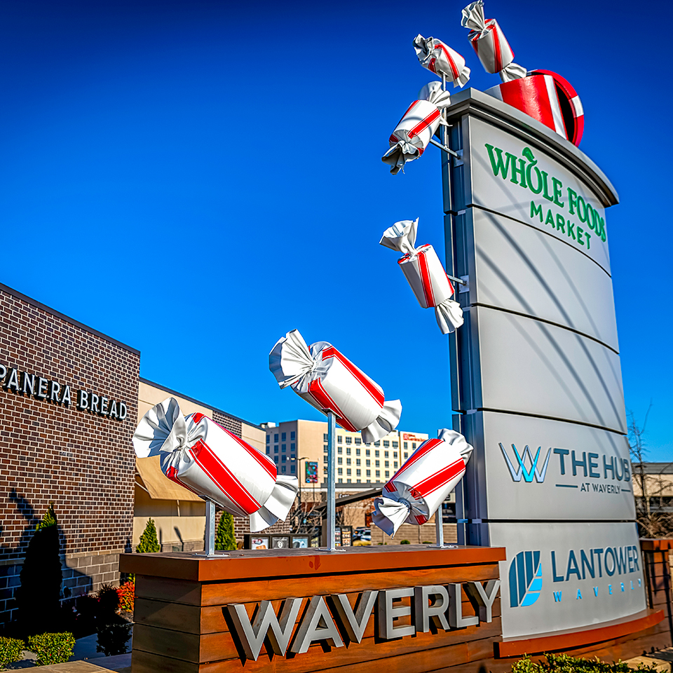 Giant 3D Christmas Decoration Candies Fall From Whole Foods Shopping Center Monument Sign