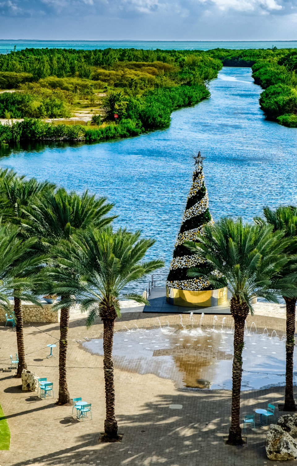 Giant Outdoor Christmas Tree with Gold and Silver Ornaments on Gold Package Base by Waterfront